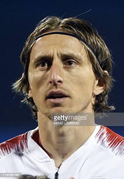 This picture taken on March 21 2019 shows Croatia's midfielder Luka Modric listening to the national anthem ahead of the Euro 2020 qualifying...
