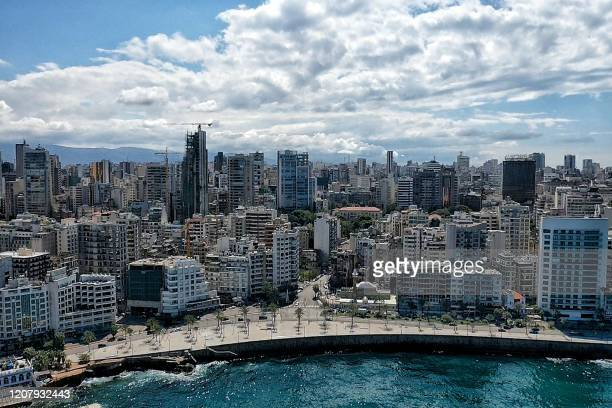 This picture taken on March 21 2020 shows an aerial view of the portion of the road along the corniche of Lebanon's capital Beirut as streets empty...