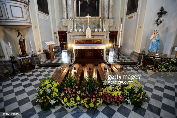 This picture taken on March 21 2020 shows coffins on the ground of the church in Serina near Bergamo northern Italy Italy on March 21 reported 793...