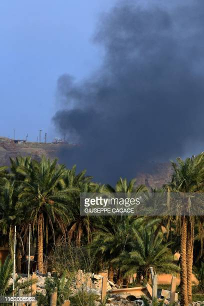 This picture taken on March 22 2019 shows smoke rising over the village of Baghouz in the eastern Syrian province of Deir Ezzor