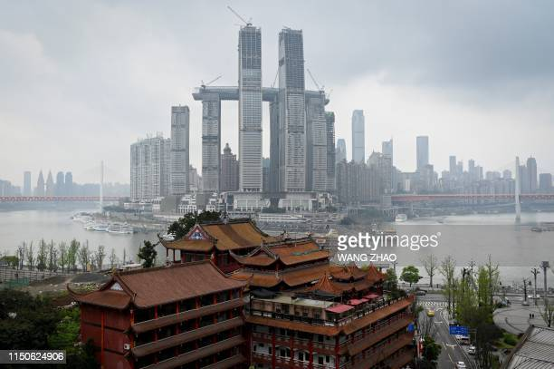 TOPSHOT This picture taken on March 24 2019 shows the Raffles City Chongqing under construction in southwest China's Chongqing Municipality In many...