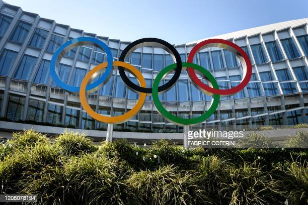 This picture taken on March 24 2020 shows headquarters of the International Olympic Committee in Lausanne as doubts increase over whether Tokyo can...