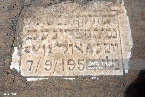 This picture taken on March 24, 2021 shows a view of a close-up view of a marker on a grave at the Habibiya Jewish cemetery in Iraq's capital...