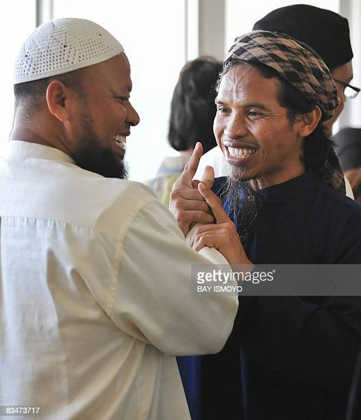 This picture taken on March 26 2008 shows Ali Ghufron one of the three convicted Bali bombers talking to an unidentified man inside the Batu prison...