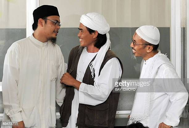 This picture taken on March 26 2008 shows Amrozi one of the three convicted Bali bombers talking to unidentified men inside Batu prison on the...