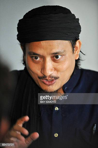 This picture taken on March 26 2008 shows convicted Bali bomber Imam Samudra gesturing during an interview with Agence FrancePresse at Batu prison on...