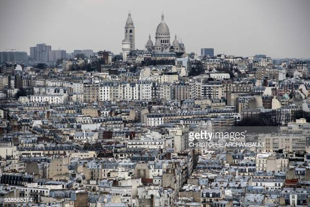 This picture taken on March 26 2018 shows the Sacre Coeur Basilica sitting atop Montmartre hill in Paris