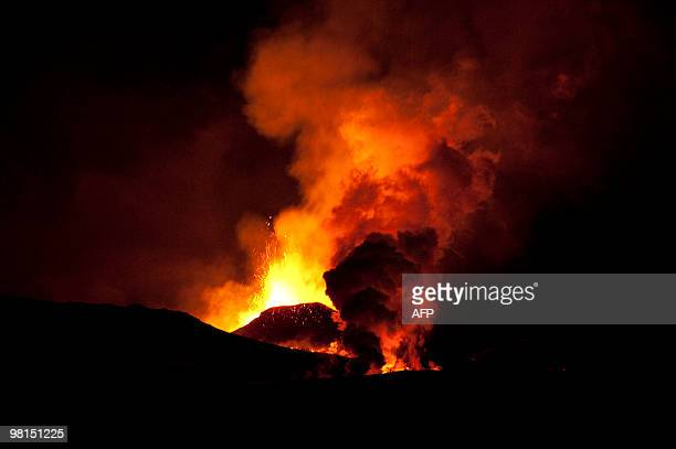 This picture taken on March 27, 2010 shows lava spurting out of the site of a volcanic eruption at the Fimmvorduhals volcano near the...
