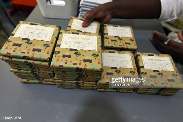 This picture taken on March 27 2019 shows piles of packed chocolate at the handmade organic raw chocolate factory Mon Choco in Abidjan Ivorian Dana...
