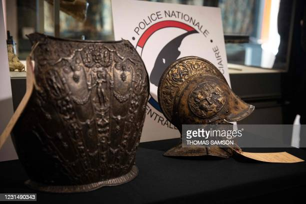 This picture taken on March 3 shows a breastplate and a ceremonial helmet during their official restitutions by the French Central Directorate of the...