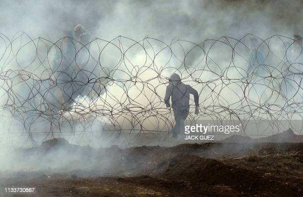 This picture taken on March 30, 2019 from the southern Israeli kibbutz of Nahal Oz across the border from the Gaza Strip, shows a Palestinian...