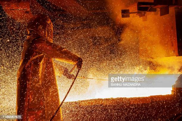 TOPSHOT This picture taken on March 30 2019 shows a worker manning a furnace during the nickel smelting process at Indonesian mining company PT...