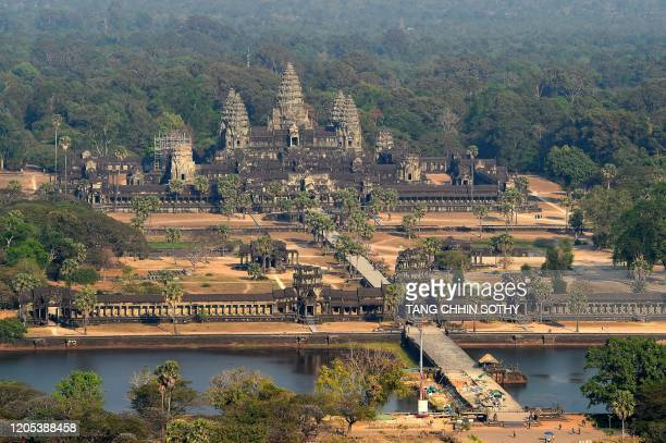 This picture taken on March 5, 2020 shows an aerial view of Angkor Wat temple in Siem Reap province. - The deadly COVID-19 novel coronavirus epidemic...