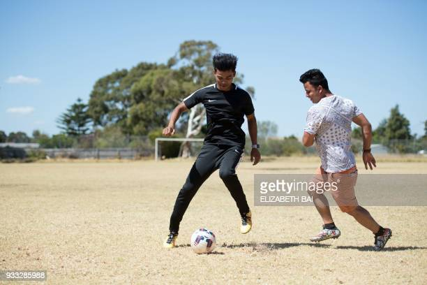 This picture taken on March 6 2018 shows Rohingya refugees Mohamed Younis and Anwar Ibrahim playing football in Melbourne The Rohingya in Australia...