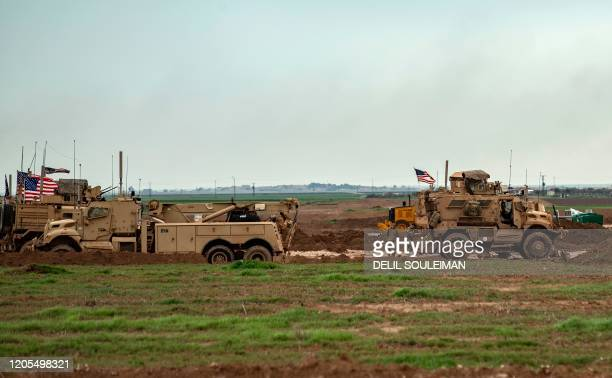 This picture taken on March 6 2020 shows a view of US soldiers and military vehicles at a military base used by forces that are part of the...