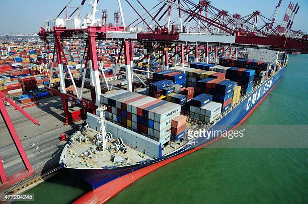 This picture taken on March 7 2014 shows containers waiting to be transported in Qingdao port in Qingdao east China's Shandong province China...
