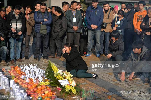 This picture taken on March 7 2014 shows relatives mourning victims at the scene of the terror attack at the main train station in Kunming southwest...