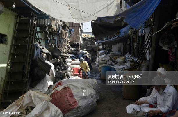 This picture taken on March 7, 2019 shows sacks of plastic waste arranged outside a factory in Dharavi, Asia's largest slum in Mumbai. - Residents of...