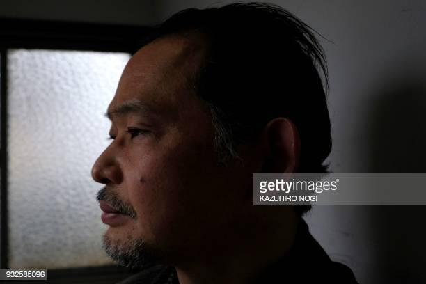 This picture taken on March 8 2018 shows Ikeida a 55year Japanese man who has chosen to shut himself completely away from society posing for a...