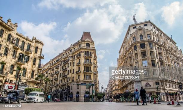This picture taken on March 8, 2019 shows a view of the central Talaat Harb square in the Egyptian capital Cairo's downtown district. - Cairo's...