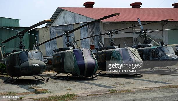 This picture taken on March 9 2014 shows a raw of USmade UH1 helicopters also known as Huey left from the Vietnam War at a corner inside Tan Son Nhat...