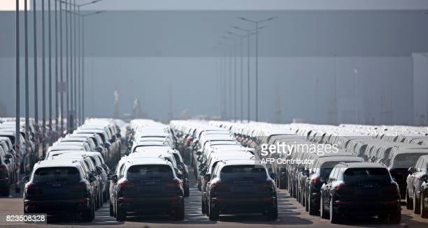 This picture taken on March 9 2016 shows new Porsche Cayenne at the Porsche factory in Leipzig Berlin orders recall of 30000 Porsches over emissions...