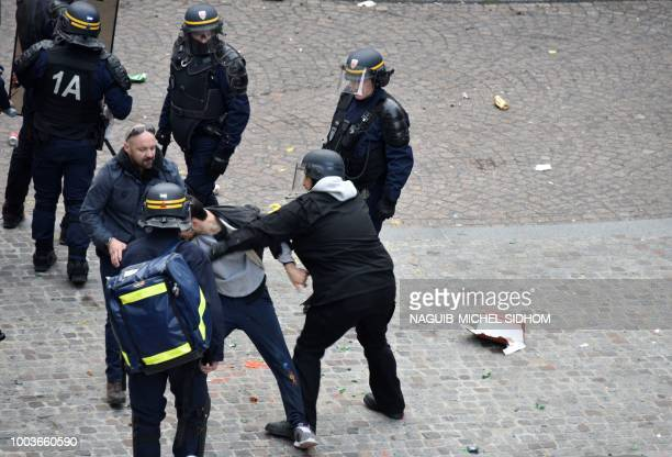 TOPSHOT This picture taken on May 1 2018 shows Elysee Chief Security Officer Alexandre Benalla wearing a police visor next to Vincent Crase a...