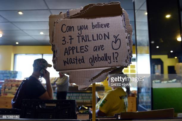 This picture taken on May 10 2017 shows a sign at OzHarvest Market a recycled food supermarket in Sydney Australia's first recycled supermarket is...