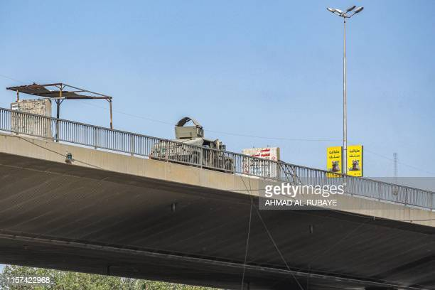 This picture taken on May 10 2019 shows an Iraqi military vehicle driving along the Jadiriya bridge crossing the Tigris river in the centre of the...
