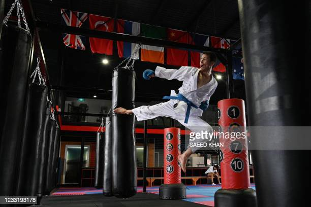This picture taken on May 11, 2021 shows Afghan-born refugee and karate competitor Asif Sultani training on the outskirts of Sydney as he competes...