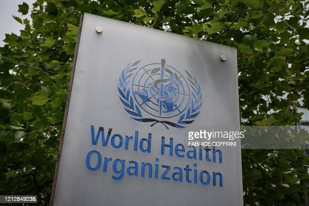 This picture taken on May 12 shows a sign of the World Health Organization in Geneva next to their headquarters amid the COVID19 outbreak caused by...
