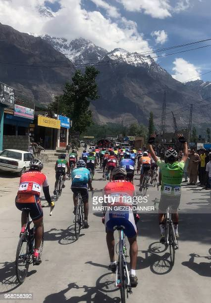 This picture taken on May 12 shows Pakistani and foreign cyclists taking part in a race of 'Tour de Khunjerab' in Pakistan's northern Aliabad area in...