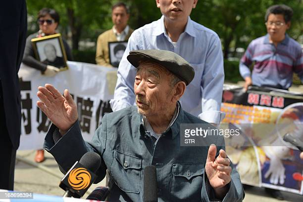 This picture taken on May 13 2013 shows 89yearold Zhang Shijie a Chinese man who says he was forced to perform hard labor in Japan during World War...