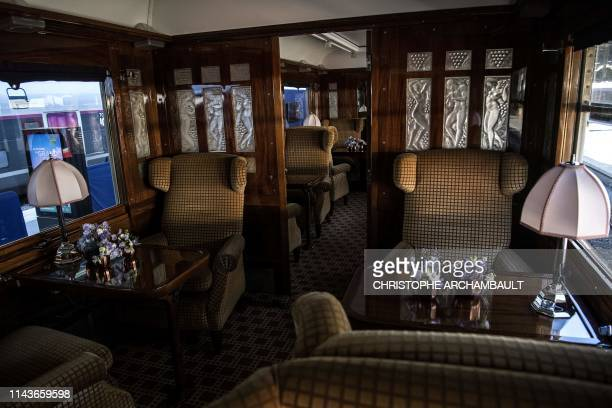 This picture taken on May 13 2019 shows the interior of a carriage in a restored carriage of an Orient Express train displayed at the Gare de l'Est...