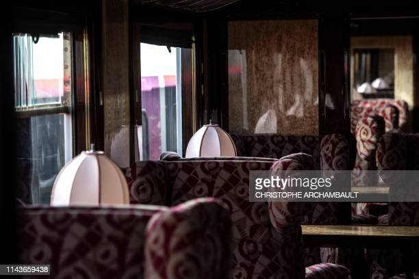 This picture taken on May 13, 2019 shows the interior of a newly-restored carriage of an Orient Express train displayed at the Gare de l'Est train...