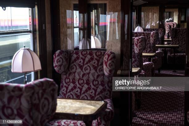 TOPSHOT This picture taken on May 13 2019 shows the interior of a newlyrestored carriage of an Orient Express train displayed at the Gare de l'Est...