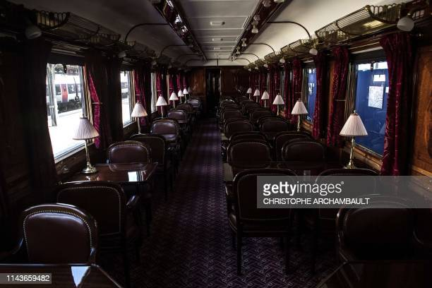 This picture taken on May 13, 2019 shows the interior of a restored carriage of an Orient Express train displayed at the Gare de l'Est train station...