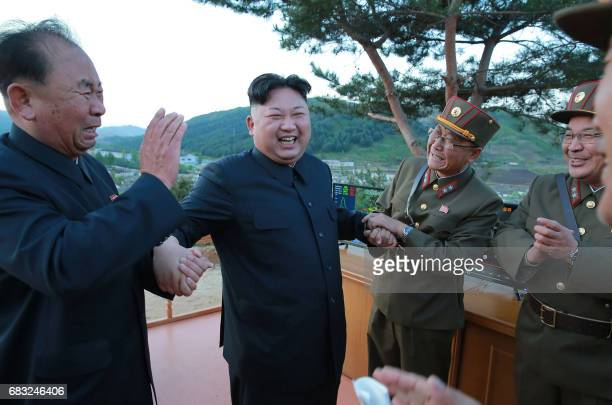 TOPSHOT This picture taken on May 14 2017 and released from North Korea's official Korean Central News Agency on May 15 shows North Korean leader Kim...