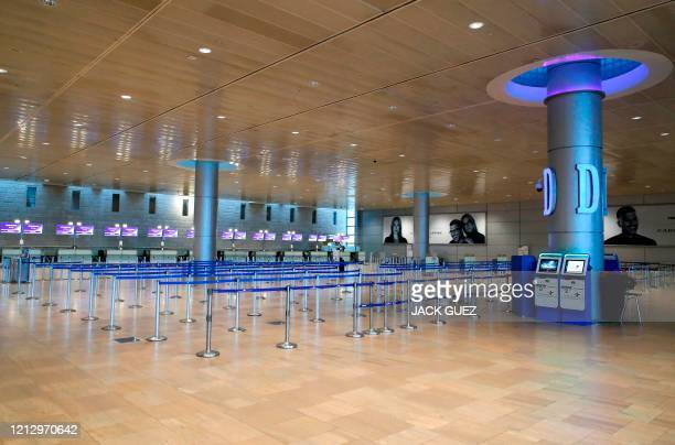 This picture taken on May 14, 2020 shows a view of the empty check-in counters of Israel's national flag carrier El-Al, at a terminal at Ben-Gurion...