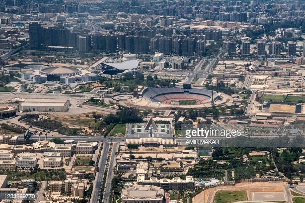 This picture taken on May 14, 2021 shows an aerial view of the Cairo International Convention Centre complex, the nearby the Tomb of the Unknown...