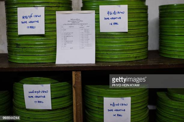 This picture taken on May 15 2018 shows cases of old negative films stored at the state archive building in Yangon The restoration of a 1934...