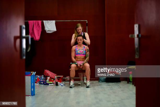 This picture taken on May 16 shows a dancer getting ready before the finals of the 2018 World Pole Dance Championships in Tianjin
