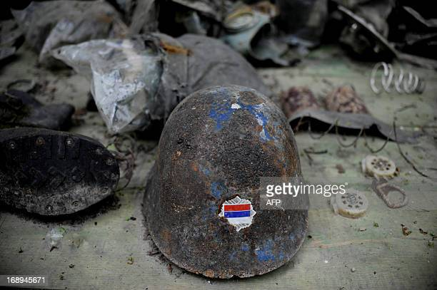 This picture taken on May 17 2013 shows a helmet with a Serbian flag as members of the Kosovo Security Force search for mines and unexploded devices...