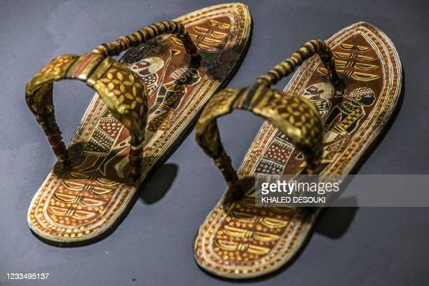 This picture taken on May 17, 2021 shows a replica of a sandal found at the tomb of Tutankhamun, fabricated at the Egyptian government's Konouz...