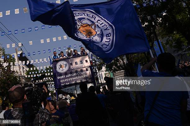 This picture taken on May 19 2019 shows Leicester City team celebrates with the Premier League Trophy during a trophy parade in Bangkok Thailand