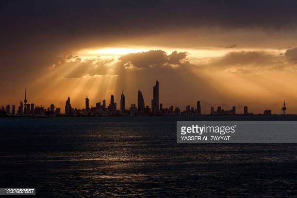 This picture taken on May 2, 2021 shows a view of the Kuwait City skyline at sunset.