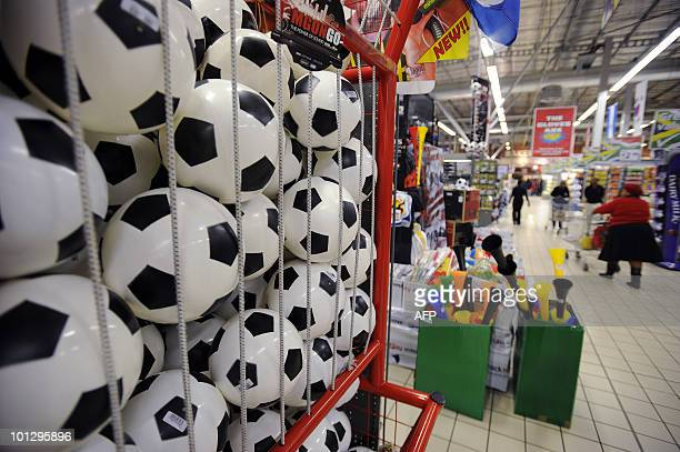 This picture taken on May 21 2010 shows footballs and vuvuzelas on sale in a supermarket at the Maponya shopping mall in Soweto twenty days before...