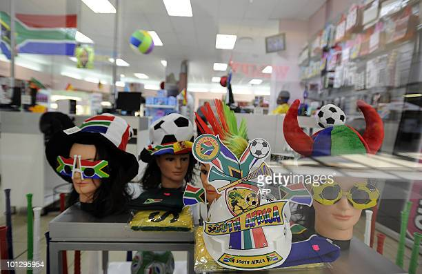 This picture taken on May 21 2010 shows goods including glasses hats makarapas for the World Cup on sale in a supermarket at the Maponya shopping...