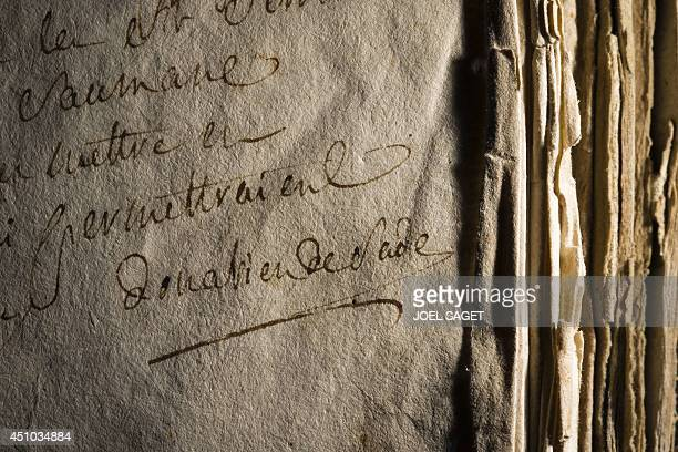 This picture taken on May 21 2014 in Boulogne Billancourt outside Paris shows a very rare genealogical volume compiled in the early 18th century by...