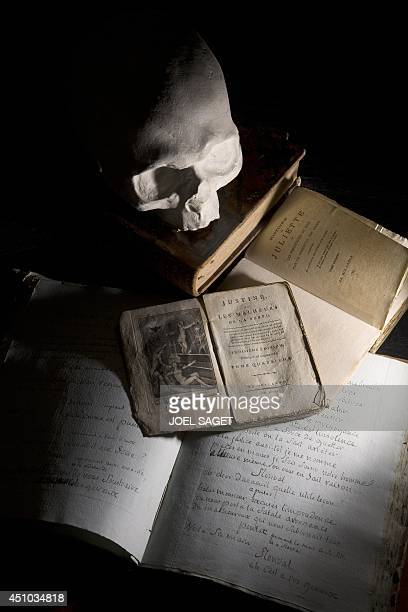 This picture taken on May 21 2014 in BoulogneBillancourt outside Paris shows a moulding of the skull of French writer the Marquis de Sade made in...
